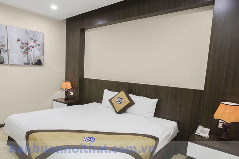 Tranh đồng hồ bình hoa mộc lan tinh tế trang trí phòng đơn khách sạn