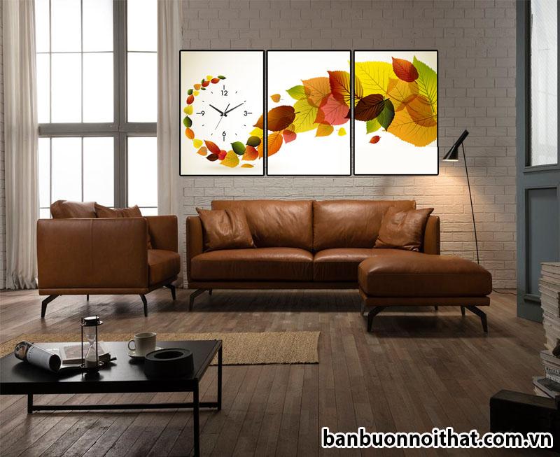 Đồng hồ tranh hình lá được dùng để trang trí phòng khách theo phong cách đơn giản