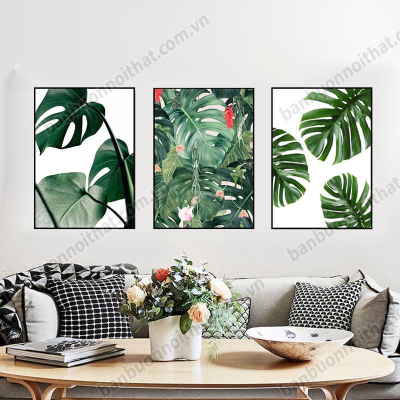 Tranh canvas hình lá cây được dùng để trang trí phòng khách với ghế sofa văng phong cách Băc Âu
