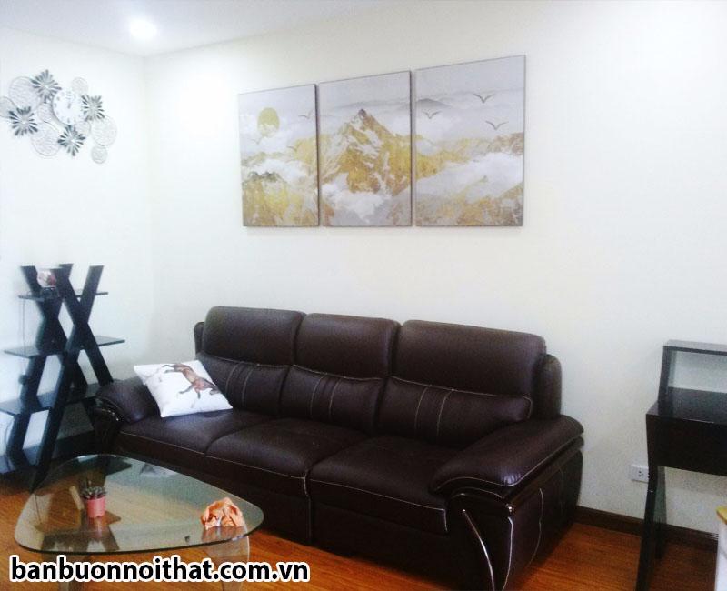 Tranh núi vàng trang trí với văng da, có thể trang trí phòng khách hoặc phòng làm việc