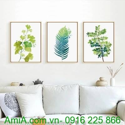 Tranh canvas hình lá cây thường được trang trí kết hợp cùng sofa da hoặc nỉ