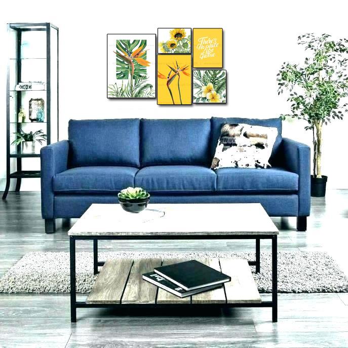 Tranh treo tường trên sofa màu xanh dương